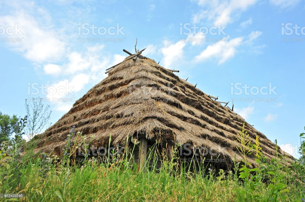 Ancient hut with a straw roof stock photo