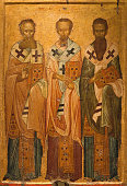 istock Ancient icon of The Three Hierarchs - Basil the Great, Gregory the Theologian and John Chrysostom. Thessaloniki, Greece 1293209113