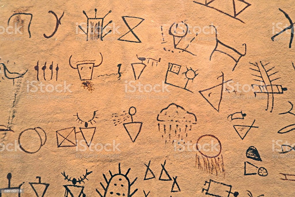 Ancient Indian symbols drawn on a piece of cured leather. stock photo
