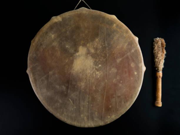 Ancient indian tambourine drum drumstick replica stock photo