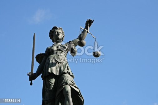 300 year old statue of Lady Justice overseeing the Well of Justice  at Frankfurts Roemer Square / Germany,