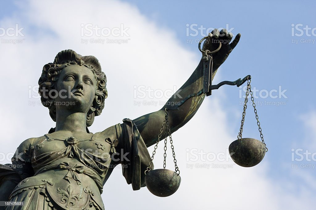 ancient Lady Justice statue half portrait royalty-free stock photo