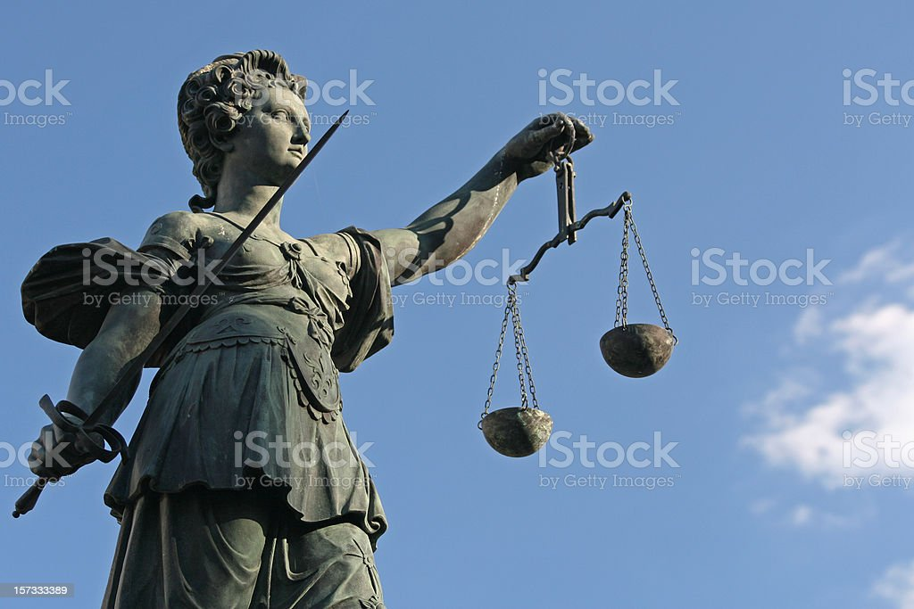 ancient Lady Justice statue royalty-free stock photo