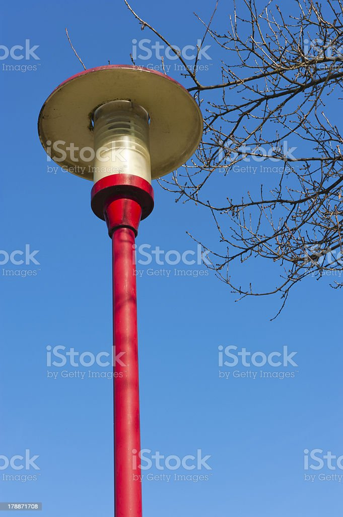 Ancient lamppost at parking of gasstation on highway royalty-free stock photo