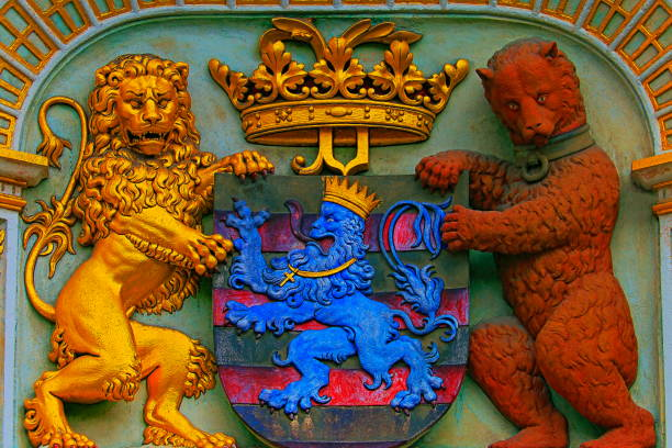 Ancient Lion, bear and shield with Bruges coat of arms details – Bruges, Belgium stock photo