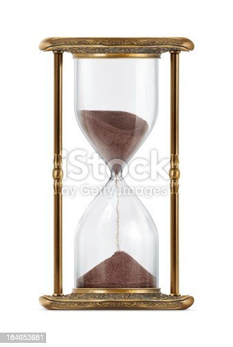 An ancient looking hourglass isolated on white background.