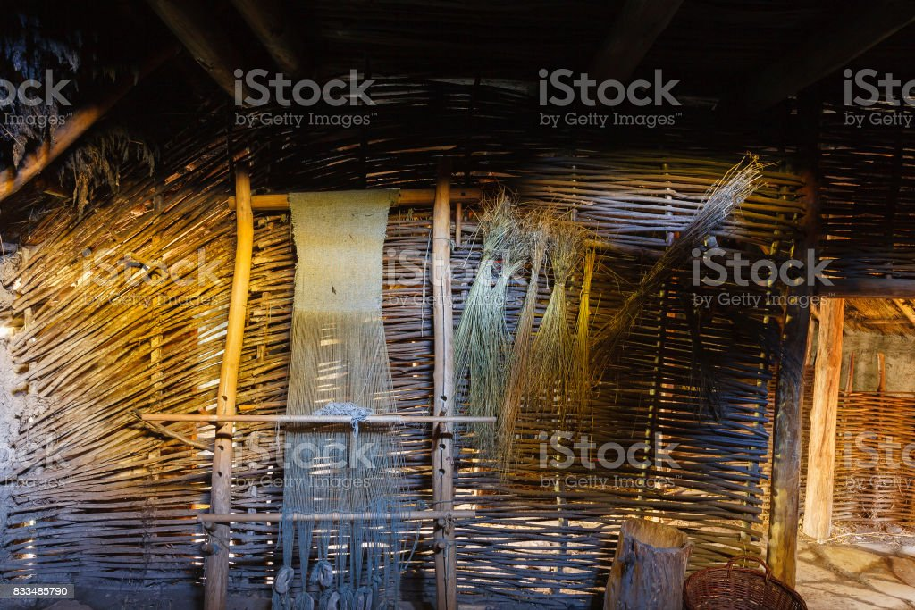 Ancient loom in an old longhouse stock photo