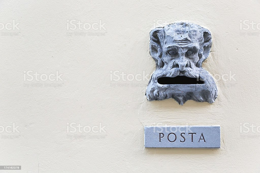 Ancient mailbox with the shape of a head royalty-free stock photo