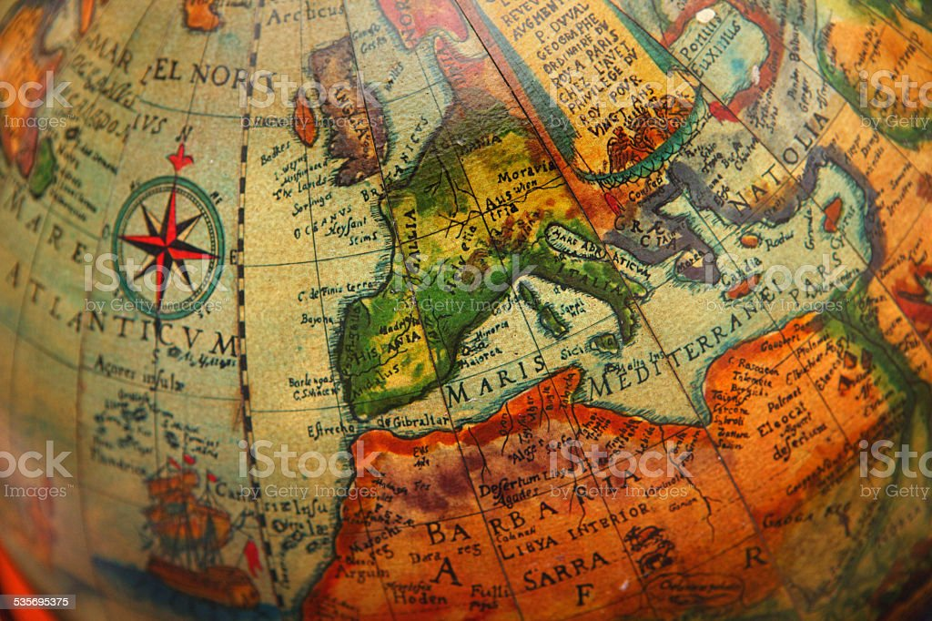 Ancient map of Europe on a old navigation globe stock photo