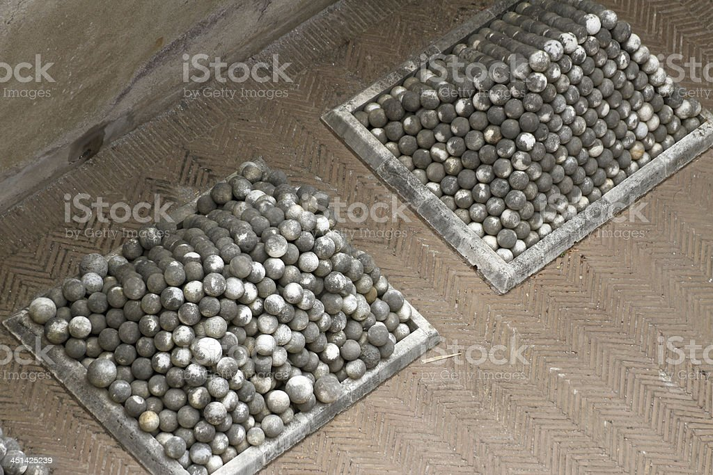 ancient marble cannonballs to Castel Saint Angel in Rome stock photo