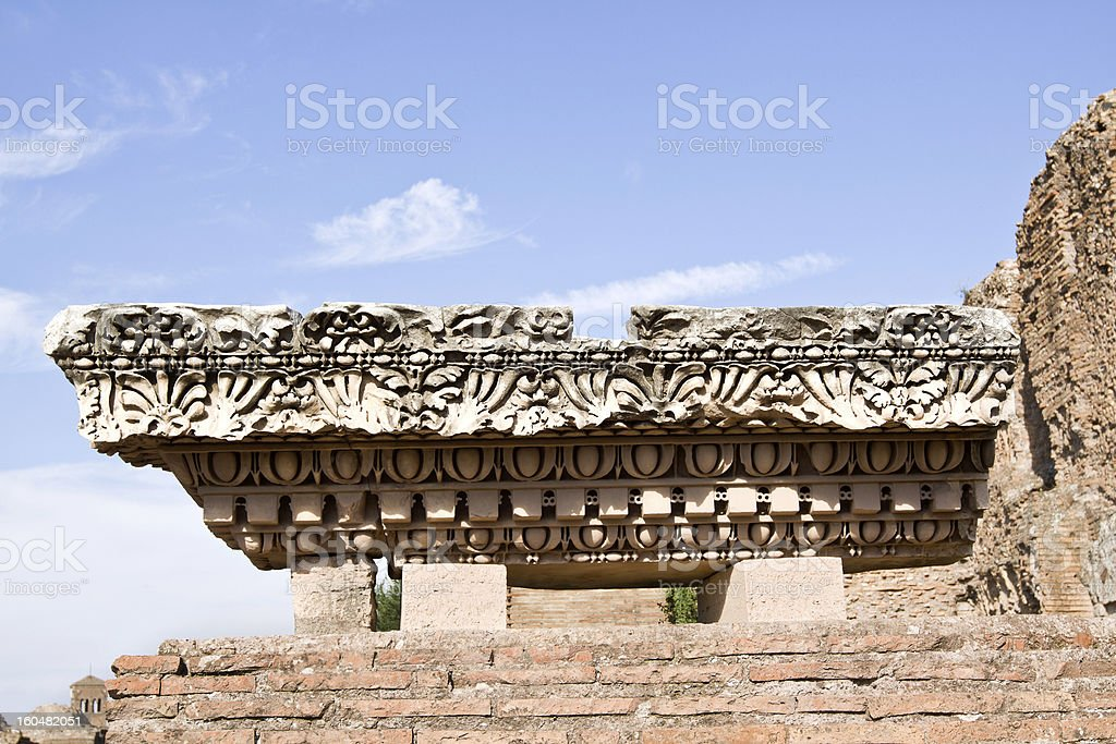 Ancient marble column against a blue sky. Rome, Italy royalty-free stock photo