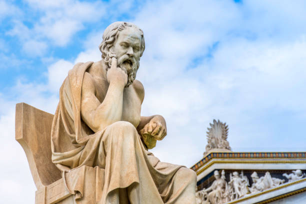 ancient marble statue of the great greek philosopher socrates on background the blue sky - statua foto e immagini stock
