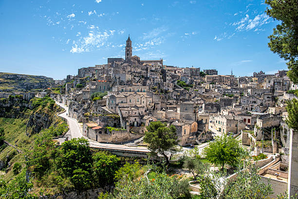 Ancient Matera Sassi under Blue Skies UNESCO World Heritage Site Matera in Southern Italy has been inhabited since the Palaeolithic. The city was allegedly founded by the Romans in the 3rd century BC. matera italy stock pictures, royalty-free photos & images