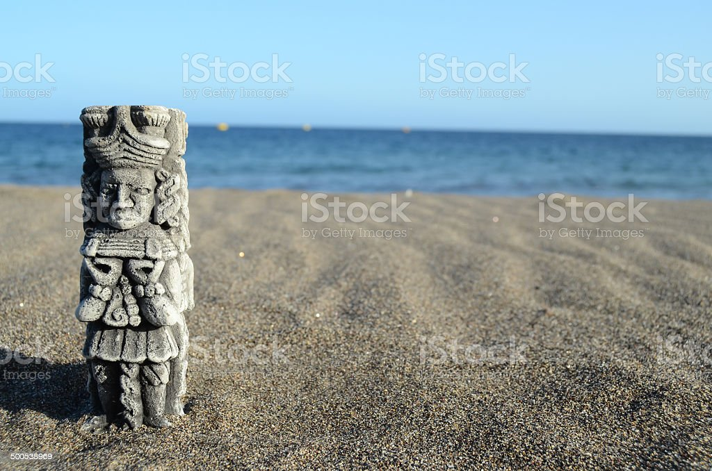 Ancient Maya Statue on the Sand Beach stock photo