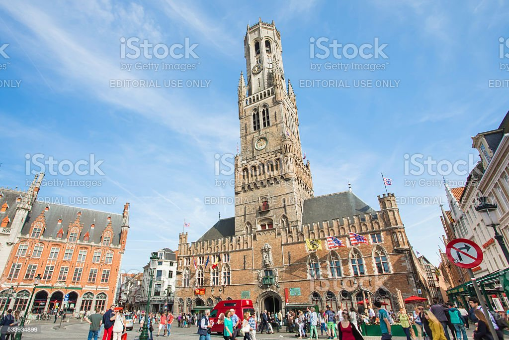 Ancient medieval tower with clock in The belfry of Bruges stock photo