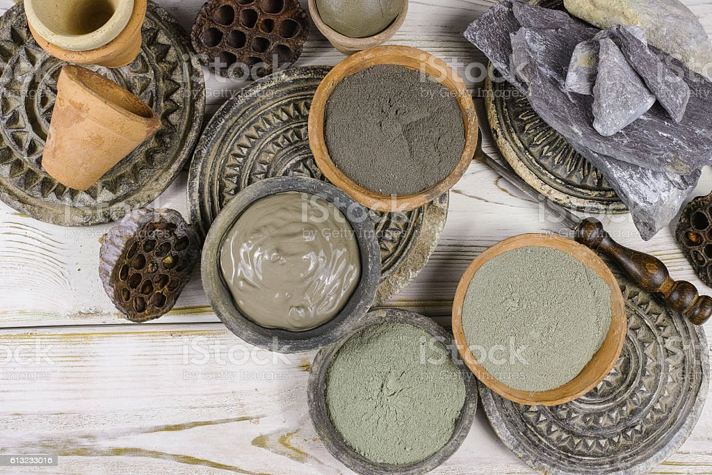 Ancient minerals black, green, blue clay powder and mud mask stock photo