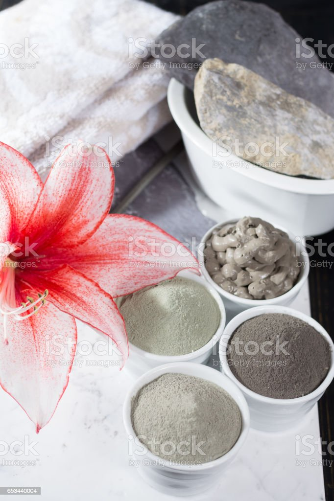 Ancient minerals - luxury face and body spa treatment, clay powder and mask stock photo