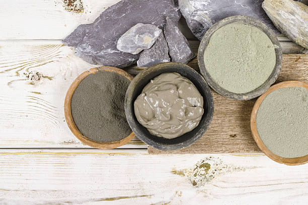 Ancient minerals - ochre, green, blue clay powder, mud mask stock photo
