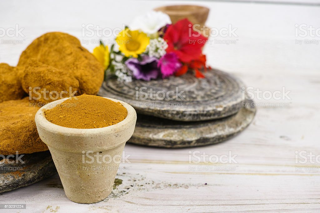 Ancient minerals - ochre stones and powder natural color pigment stock photo