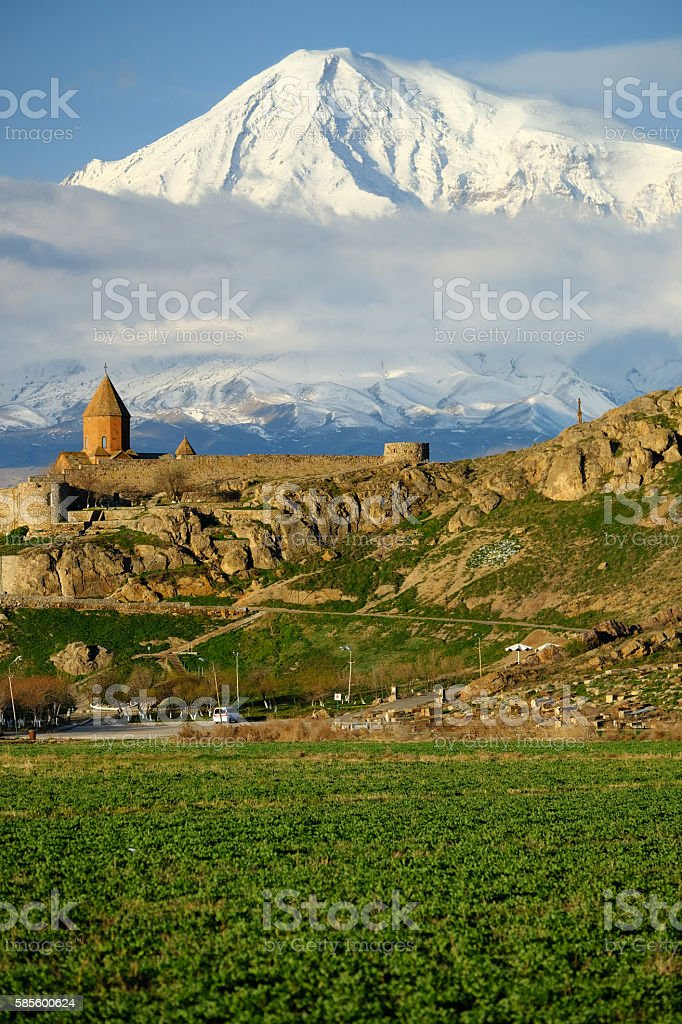 Ancient monastery in front of mountain stock photo