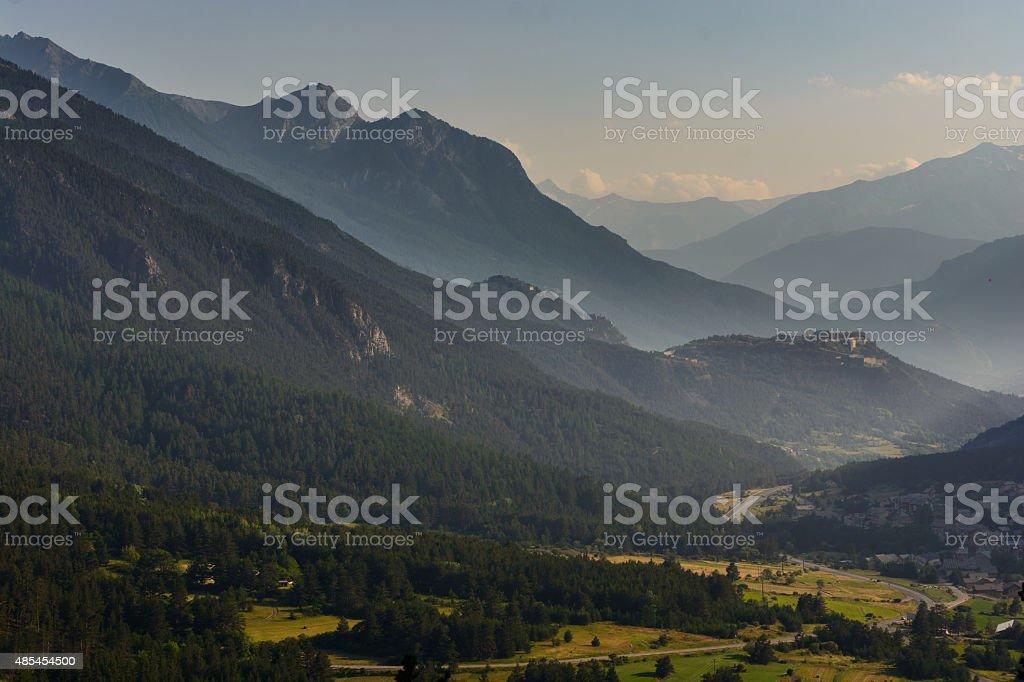 Ancient mountain forts overlooking mountain pass sunbeams stock photo