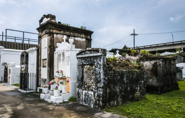 ancient mystical and mysterious st. louis cemetery in new orleans - st louis стоковые фото и изображения