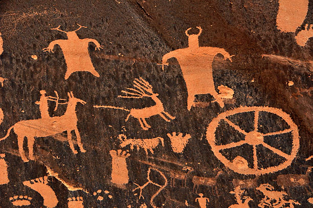 ancient native american cave drawings of animals and tools - hopi stock photos and pictures