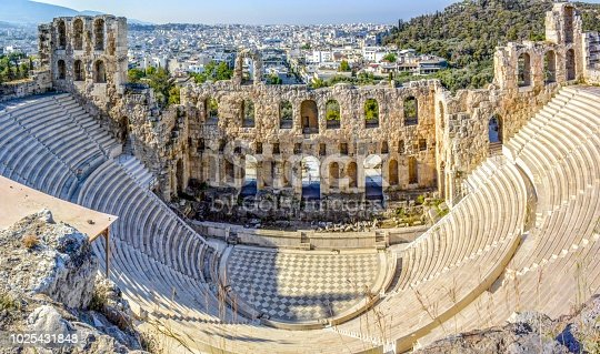 Ancient Odeon of Herodes Atticus in Athens, Greece on Acropolis hill with view over the city,