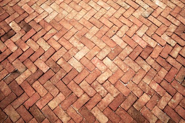 Ancient of light rose tone brick floor pavement stones luxury wall stock photo