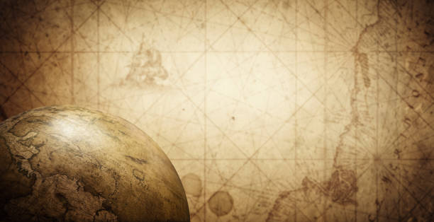Ancient old globe on the vintage map background. stock photo