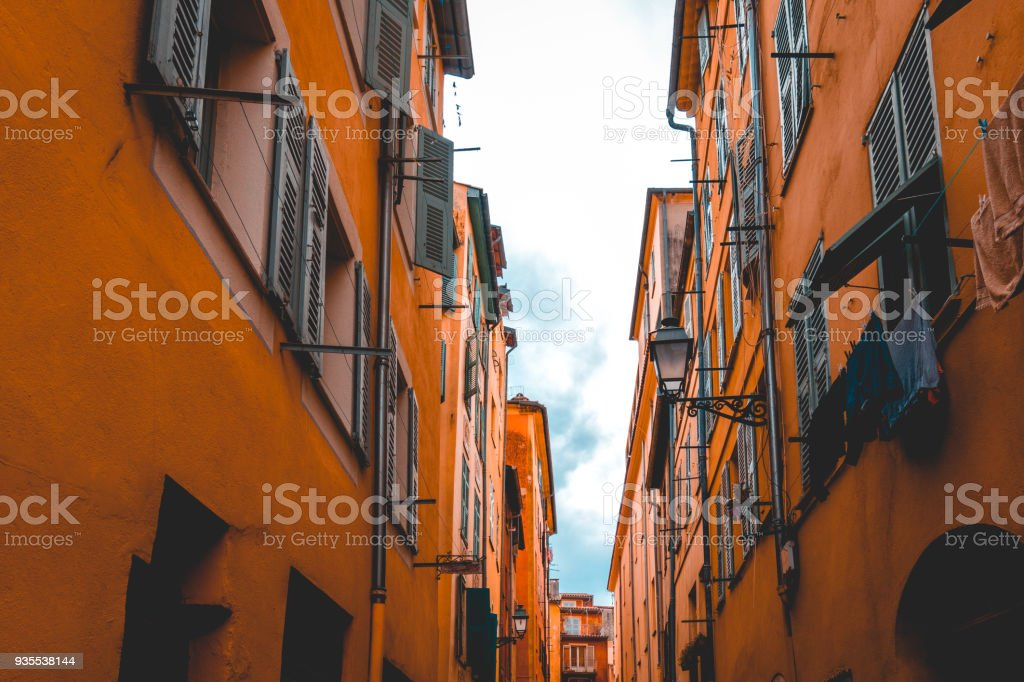 ancient orange houses in a alley at nice stock photo