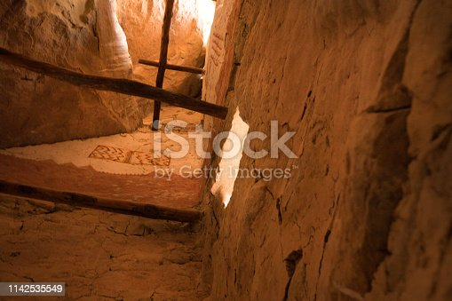 Wooden posts and painted geometric design on an interior adobe wall inside a tower at Cliff Palace, Ancient Pueblo housing, Mesa Verde National Park, Colorado, USA