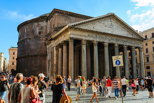 Rome, Italy, August 2014: Famous ancient monument Pantheon landmark exterior daytime, view from square crowded by tourists in Rome, Italy