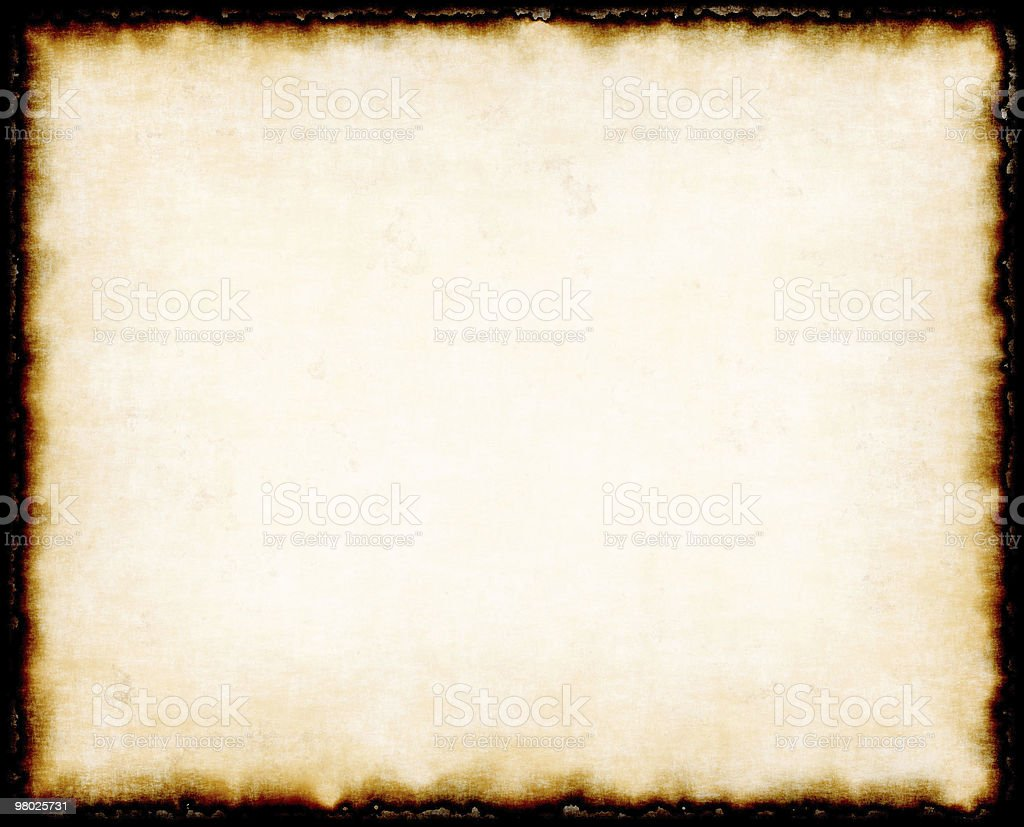 Ancient paper background with charred edges royalty-free stock photo