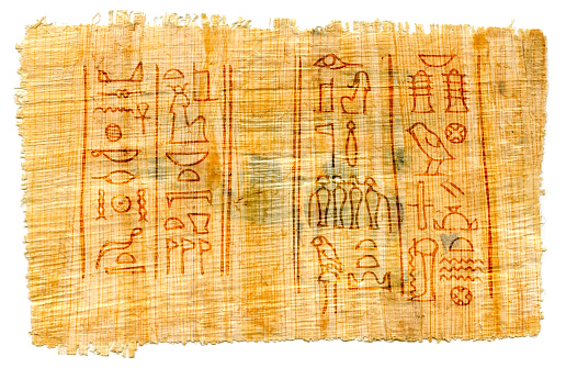 istock Ancient papyrus with Egyptian hieroglyphs: the names of the goddess of Isis (left) and the god of the Underworld of Osiris (right). Manuscript from The Karnak temple, Thebes valley, Luxor, Egypt. 1046009684