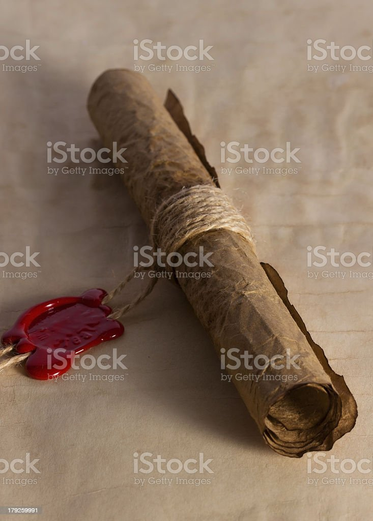 Ancient parchment scroll with wax seal royalty-free stock photo