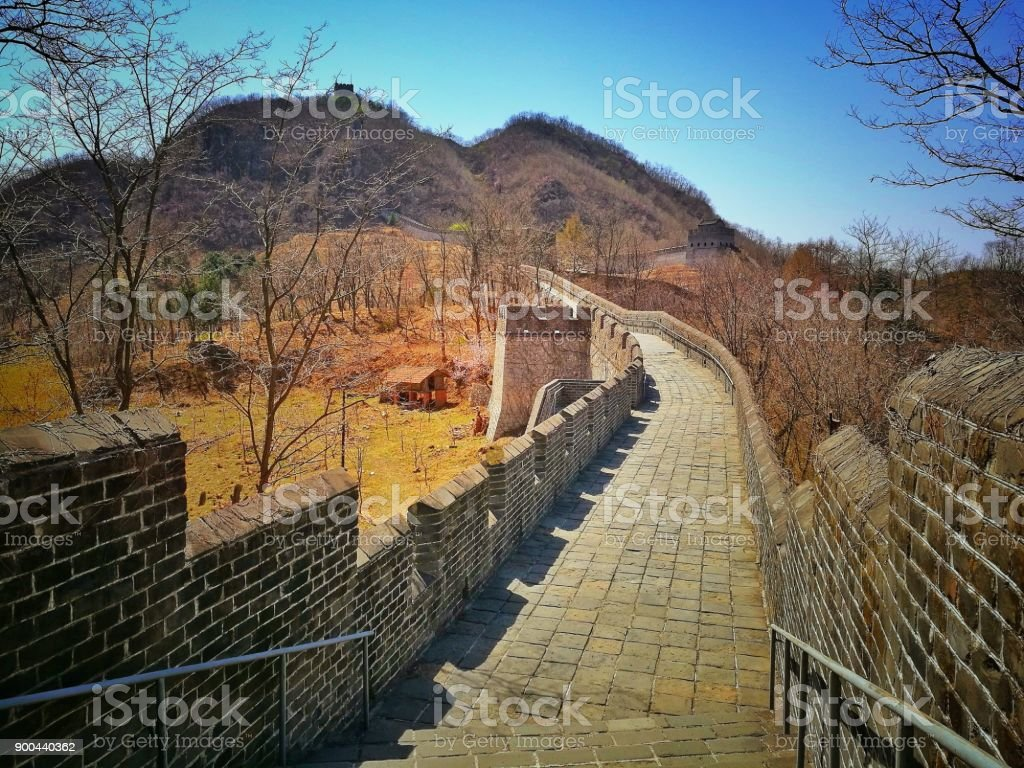 Ancient pavement of China Great Wall and trees in autumn. stock photo