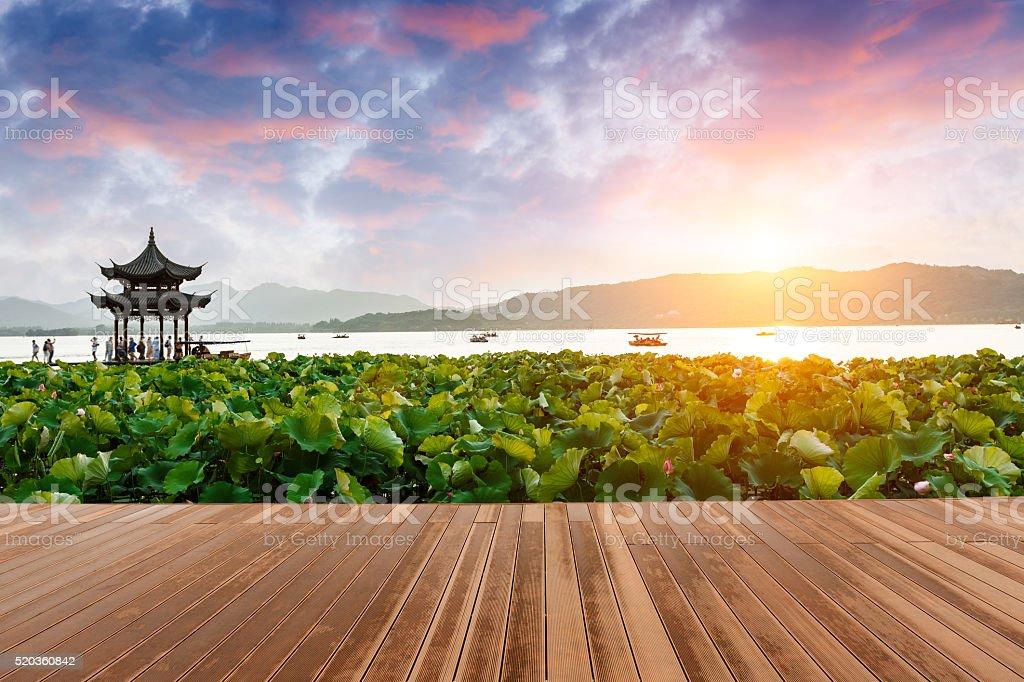 ancient pavilion of Hangzhou west lake at dusk, in China stock photo