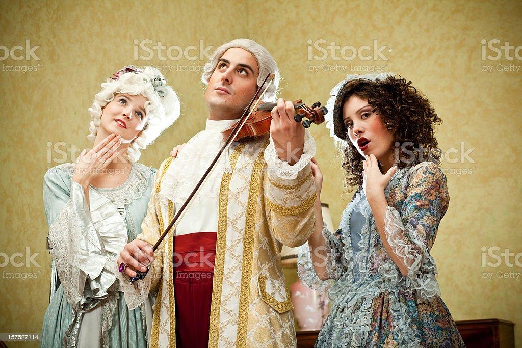 Ancient people play violin royalty-free stock photo