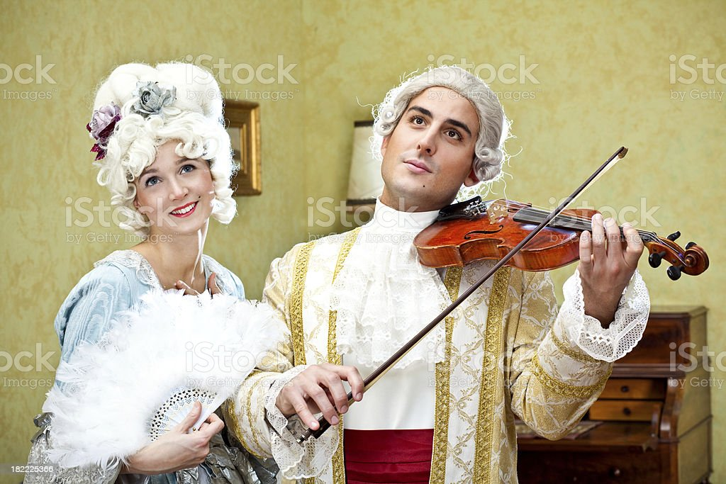 Ancient people play violin royalty-free stock photo