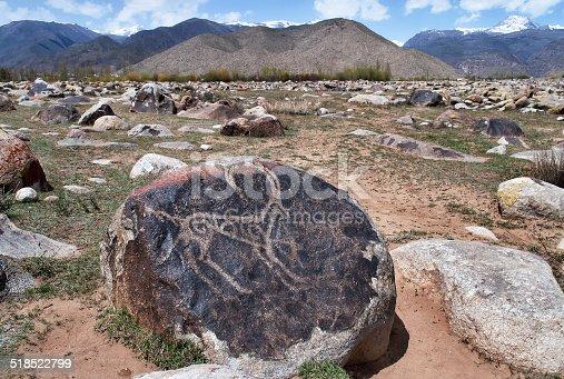 istock Ancient petroglyph on the stone 518522799