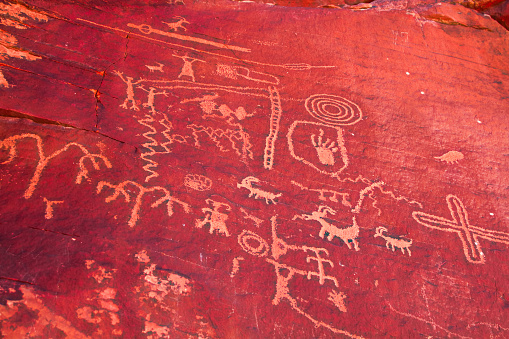 ancient petroglyphs fount on the walls of the the Mouse's Tank hiking trail in Valley of Fire State Park, Nevada