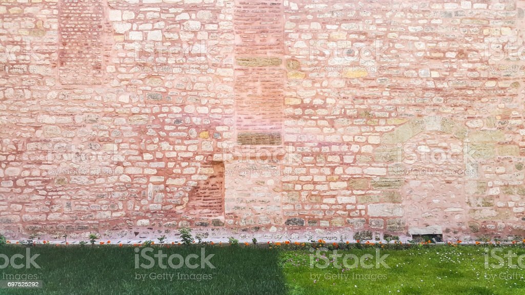 Ancient pink stone wall at the Hagia Sophia - Istanbul, Turkey stock photo