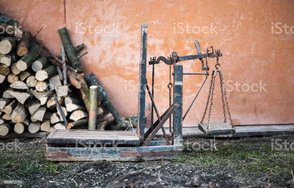 Ancient platform scales wood and iron weighing machine stock photo