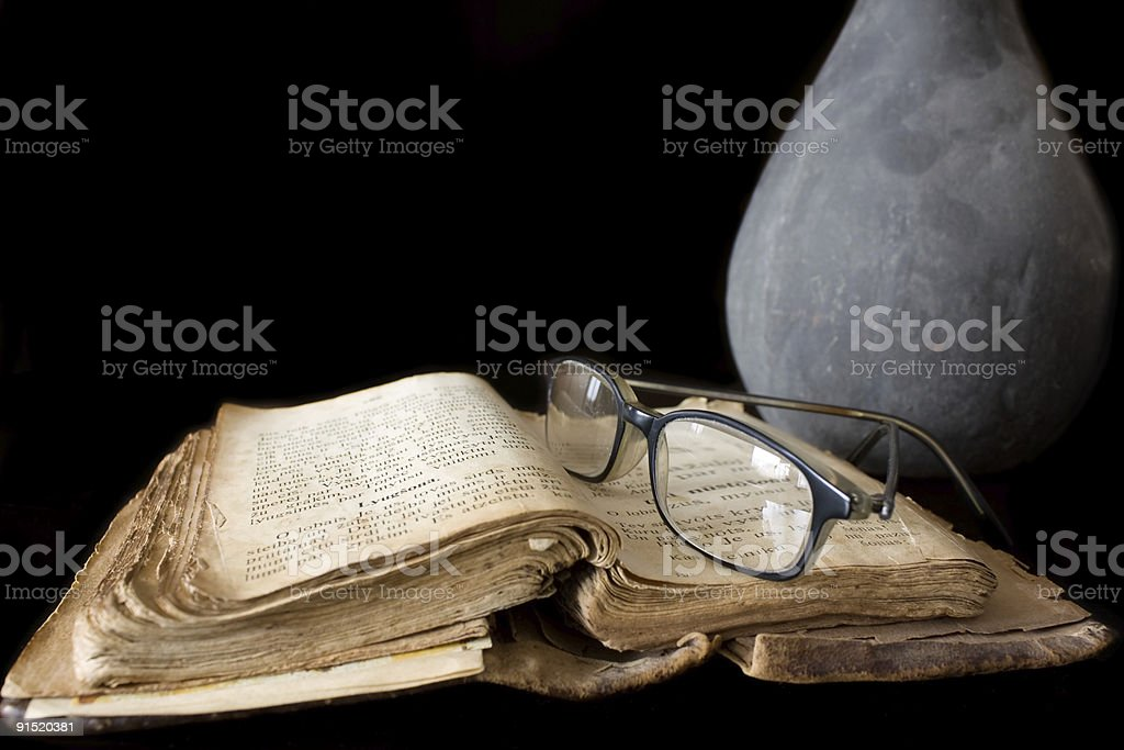 Ancient prayer book and glasses stock photo