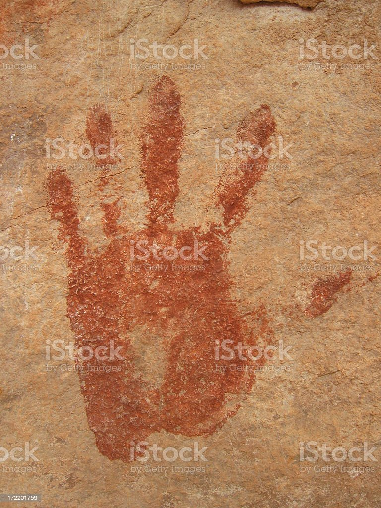 Ancient print of a left hand on a rocky wall stock photo