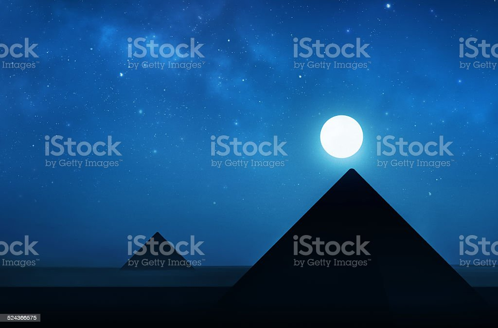 Ancient pyramids at night - night sky filled with stars stock photo