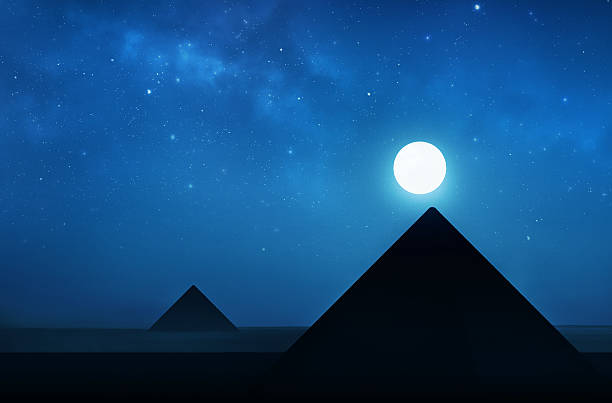ancient pyramids at night - night sky filled with stars - pyramid stock photos and pictures