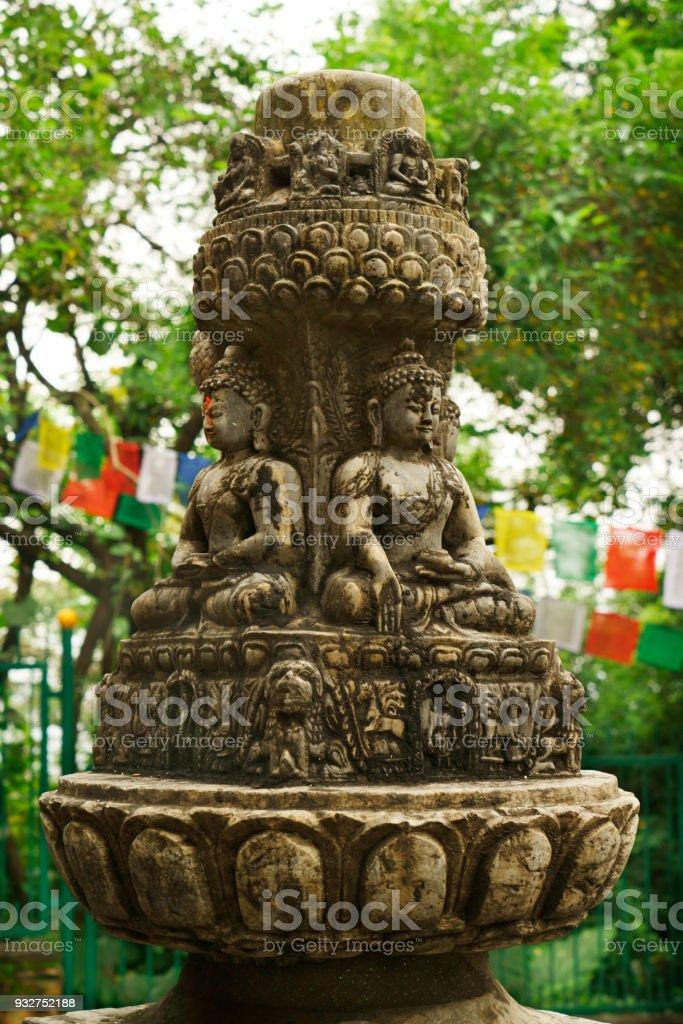 ancient religious sculpture at famous buddhistic Swayambhunath temple in Kathmandu stock photo
