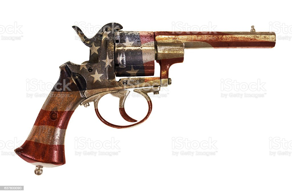 Ancient revolver with the American flag isolated on white stock photo